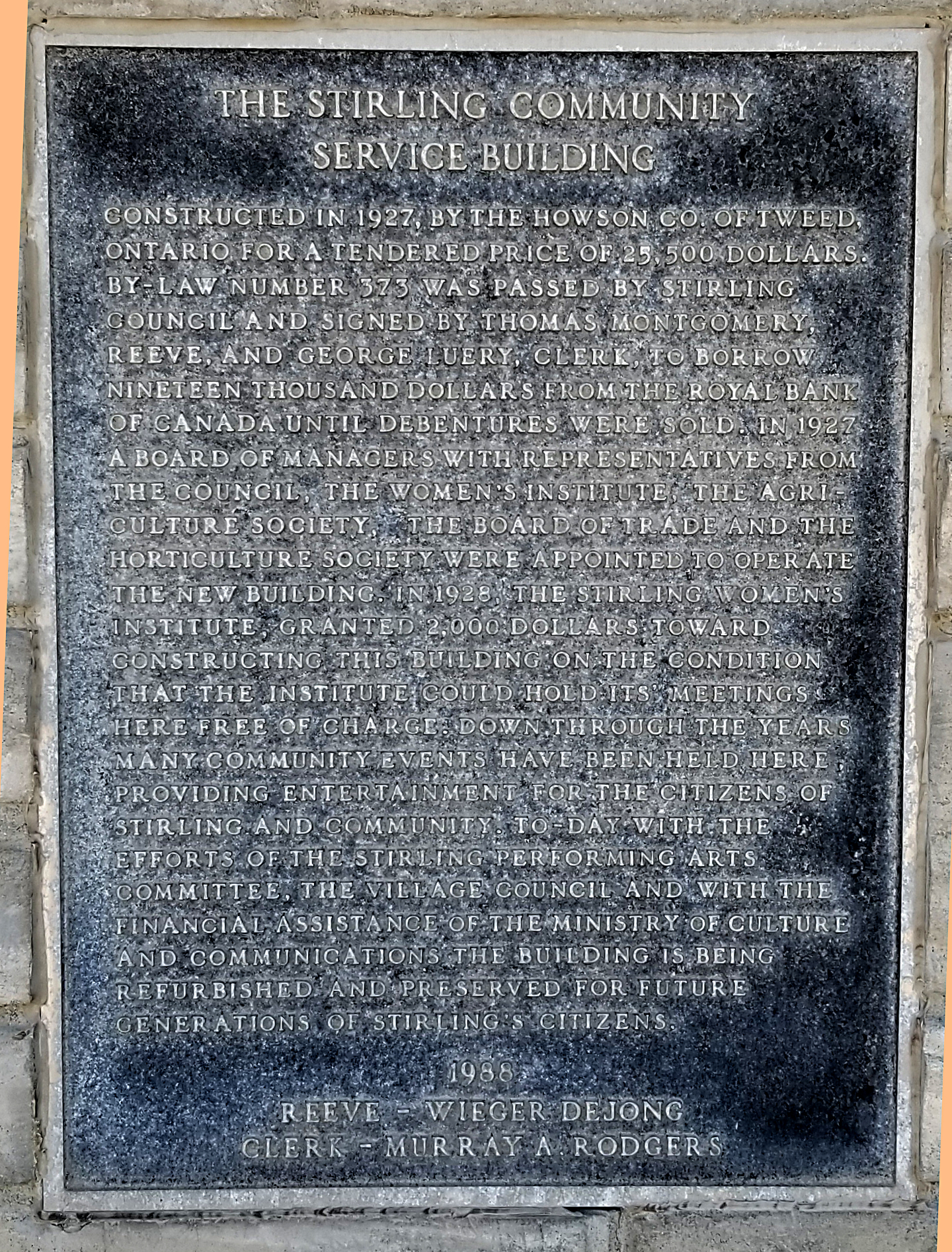 Community service building plaque